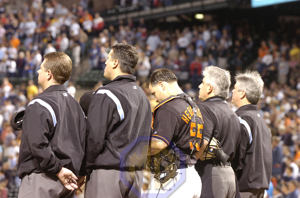 28 September 2007:  Umpires (L-R) Greg Gibson, Tony Randazzoz, Baltimore Orioles catcher Ramon Hernandez (55), Larry Vanover and Dana DeMuth (R) stand at home plate during the playing of the National Anthem prior to the game between the New York Yankees and the Baltimore Orioles.  The Orioles defeated the Yankees 10-9 in ten innings at Camden Yards in Baltimore, MD.  ****For Editorial Use Only****