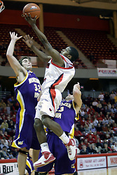 """09 January 2007: Keith """"Boo"""" Richardson takes a left hander, knocking Grant Stout and Brooks McKowen from his path. The Illinois State Redbirds, winless in the Missouri Valley Conference, knocked off the undefeated  Panthers of Northern Iowa 67-64 in overtime at Redbird Arena in Normal Illinois on the campus of Illinois State University.<br />"""