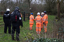 Harefield, UK. 14 January, 2020. HS2 staff and enforcement agents close to the site of a protection camp occupied by Stop HS2 activists which is currently being evicted. 108 ancient woodlands are set to be destroyed by the high-speed rail link and further destruction of trees for HS2 in the Harvil Road area is believed to be imminent.