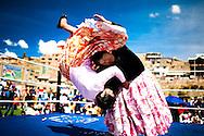 Abril y Mayo 2011/Bolivia<br /> Carmen Rosa La Luchadora de Camisa Negra levanta a su rival Julia La Pace&ntilde;a en la lucha por el titulo de Bolivia en la localidad de Yojeta Central <br /> <br /> Foto:Juan Gonzalez