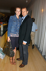 Actor XANDER ARMSTRONG and his wife HANNAH at a party to celebrate the launch of Amy Sacco's book 'Cocktails' held at Sanderson, 50 Berners Street, London W1 on 10th July 2006.<br /><br />NON EXCLUSIVE - WORLD RIGHTS