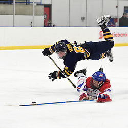 TORONTO, ON  - JAN 7,  2018: Ontario Junior Hockey League game between the Toronto Jr. Canadiens and the Buffalo Jr. Sabres, Michael Sciore #63 of the Buffalo Jr. Sabres battles for the puck with Jeremy Smith #12 of the Toronto Jr. Canadiens during the first period.<br /> (Photo by Andy Corneau / OJHL Images)