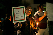 "STARKVILLE, MS – FEBRUARY 1, 2017: Matthew Little, a professor at Mississippi State University, attends a vigil honoring international students and in rejection of the travel ban is held at Mississippi State University. ""I support of the US constitutiim and the values it embodies,"" Little said.<br /> CREDIT: Bob Miller for The New York Times"