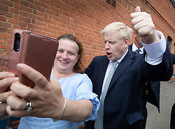 © Licensed to London News Pictures. 25/06/2019. Oxshott, UK. Conservative leadership candidate Boris Johnson poses for a selfie with local resident Eva Kennedy as he campaigns in Oxshott, Surrey. Mr Johnson is campaigning in various locations in the south east of England today. Photo credit: Peter Macdiarmid/LNP