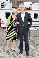 Johnnie Walker Gold Label Reserve Finale Celebration Party aboard the John Walker & Sons Voyager moored at the Prince of Wales Docks, Leith, Edinburgh, Scotland on 14th August 2013.<br /> Picture shows:-Jeremy Watson Deputy Editor of Scotland on Sunday and his wife Wendy Watson.
