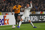Adama Traore of Wolverhampton Wanderers & Vernon De Marco of Slovan Bratislava during the Europa League match between Wolverhampton Wanderers and Slovan Bratislava at Molineux, Wolverhampton, England on 7 November 2019.