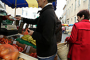 purchasing fruit and vegetables at an local outdoor market Limoux France
