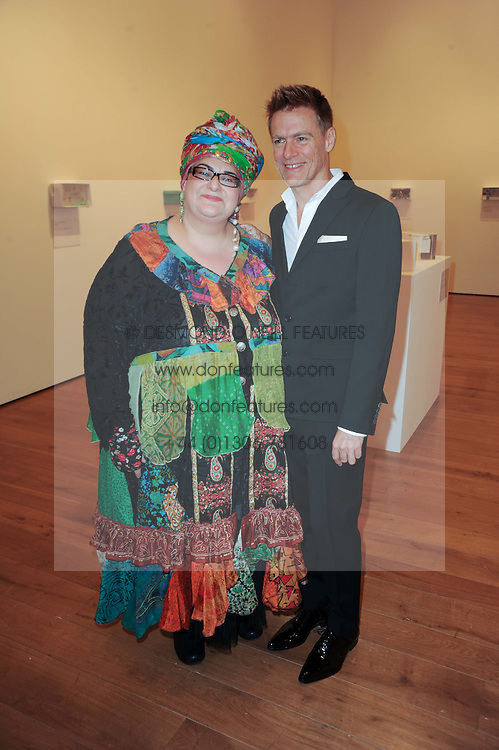 BRYAN ADAMS and CAMILLA BATMANGHELIDJH at an exhibition and charity auction entitled Shoebox Art in aid of Kids Company held at the Haunch of Venison, Burlington Gardens, London on 18th March 2010.