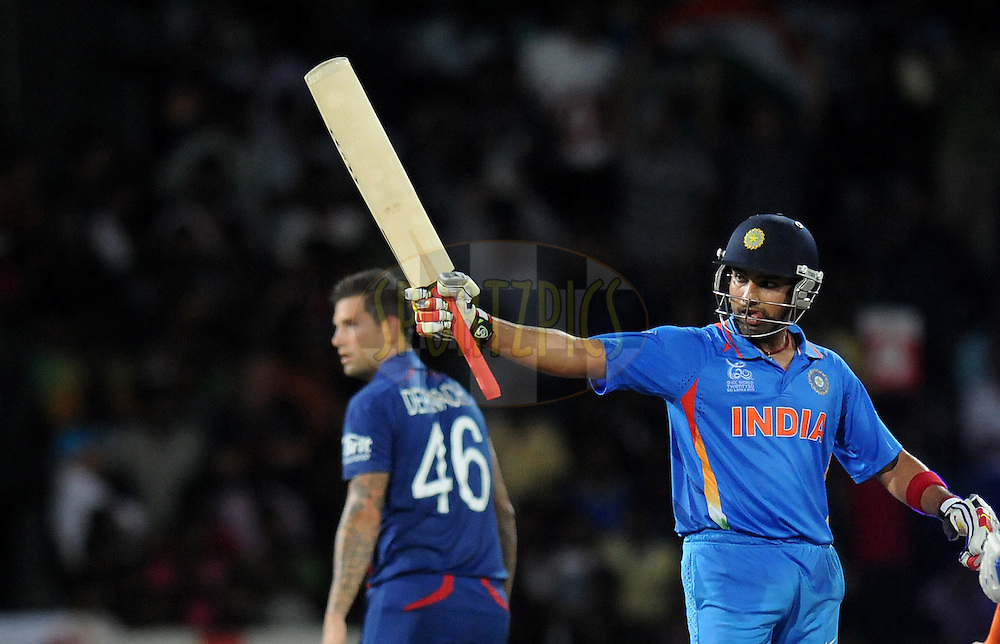 Rohit Sharma of India after scoring a half century during the 10th WT20 match between  India and England held at the Premadasa cricket stadium in Colombo on 22nd September 2012..Photo by Pal Pillai/Sportzpics...