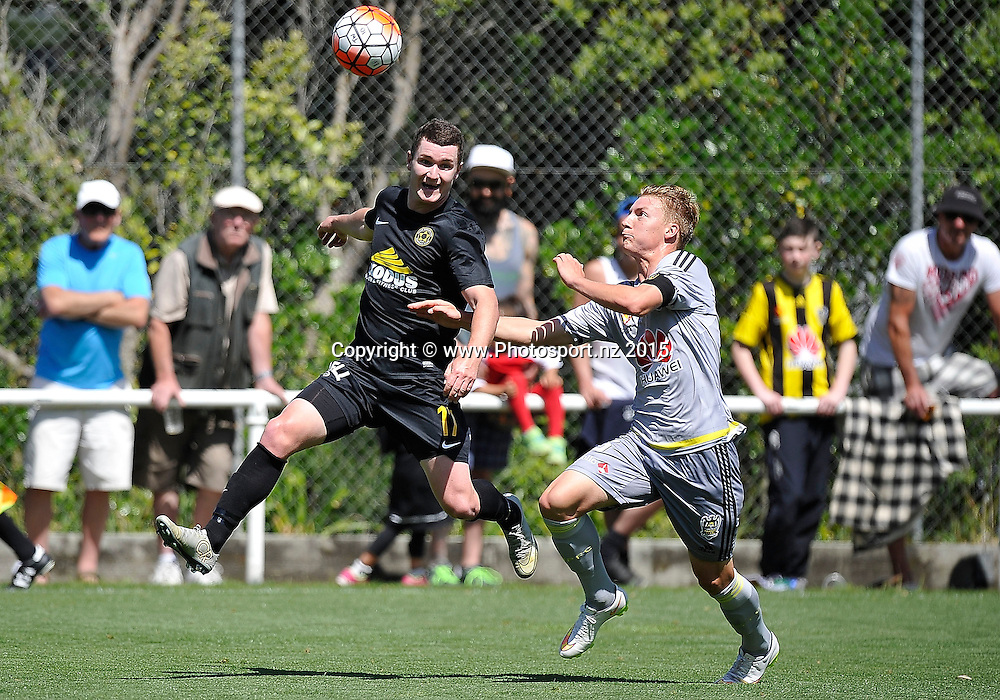 Fergus Neil (L) of Team Wellington makes a pass with James McGarry  of the Phoenix Reserves during the ASB Premiere  - Team Wellington vs Phoenix football match at David Farrington Park in Wellington on Sunday the 20th of December 2015. Copyright Photo by Marty Melville / www.Photosport.nz