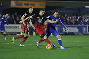 AFC Wimbledon midfielder Dannie Bulman (4) and Coventry City midfielder Callum Reilly (12)  during the EFL Sky Bet League 1 match between AFC Wimbledon and Coventry City at the Cherry Red Records Stadium, Kingston, England on 14 February 2017. Photo by Stuart Butcher.