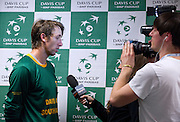 Jean Andersen of South Africa while press conference after the first single man match during first day of the BNP Paribas Davis Cup 2013 between Poland and South Africa at MOSiR Hall in Zielona Gora on April 05, 2013...Poland, Zielona Gora, April 05, 2013..Picture also available in RAW (NEF) or TIFF format on special request...For editorial use only. Any commercial or promotional use requires permission...Photo by © Adam Nurkiewicz / Mediasport
