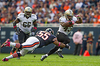 06 October 2013: Running back (43) Darren Sproles of the New Orleans Saints runs the ball and eludes a tackle by (55) Lance Briggs of the Chicago Bears during the first half of the Saints 26-18 victory over the Bears in an NFL Game at Soldier Field in Chicago, IL.