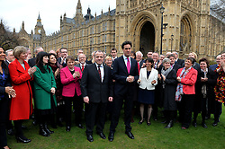 Newly Elected MP for Wythenshawe and Sale East Mike Kane MP speaks with Labour leader Ed Miliband outside of The House of Commons on College Green, London, UK with members of the Labour party behind.<br /> Monday, 24th February 2014. Picture by Ben Stevens / i-Images