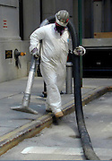 "Workers wear protective gear while cleaning the streets in lower Manhattan days after the Sept. 11th attack. Through my eyes and with my camera I am able to see the world we live in, and try to bring things into focus. Photography preserves my vision of what ""I see"" at a specific time and place- a moment. Creating a bond between  me and my subject and capturing and emotion for eternity. Having lived and worked in New York City for over 15 years when 911 happened. I had to go and ""see"" with my camera what lower Manhattan was like after this horrific attack on our Nation. The World Trade Center owned the skyline in lower Manhattan making it feel more like a canyon. After the Twin Towers fell, and I saw with my own eyes and camera the destruction, I realized what little land they actually sat on. The Twin Towers may not have occupied a large plot of land but they now touched everyones life. Photo©SuziAltman"