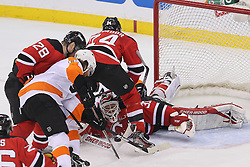 May 3, 2012; Newark, NJ, USA; New Jersey Devils goalie Martin Brodeur (30) makes a save on Philadelphia Flyers left wing Scott Hartnell (19)  during the second period in game three of the 2012 Eastern Conference semifinals at the Prudential Center.
