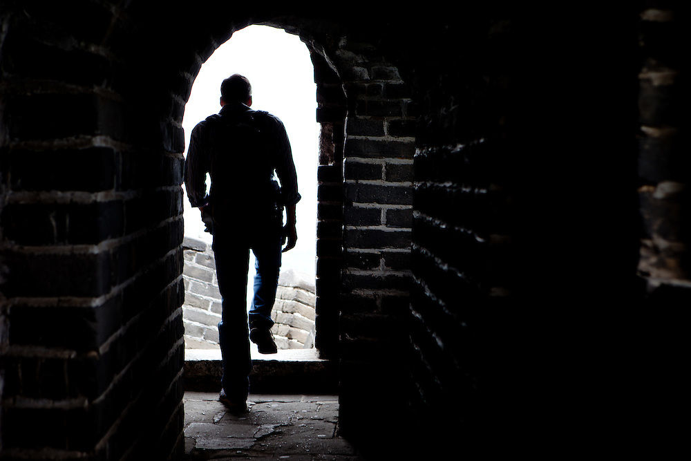 Silhoutte of a visitor at the Mutianyu Great Wall. Mutianyu is a section of the Great Wall of China located in Huairou County 70km northeast of Beijing. The Mutianyu section of the Great Wall is connected with Jiankou in the west and Lianhuachi in the east. As one of the best-preserved parts of the Great Wall, the Mutianyu section of the Great Wall used to serve as the northern barrier defending the capital and the imperial tombs.