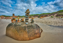 Rocks stacked on a boulder on Lucy Vincent Beach