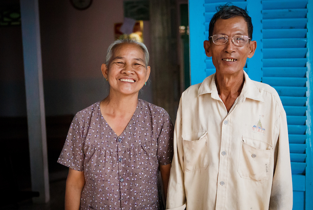 CAPTION: Mai Van Cho and his wife Nguyen Thi A standing outside their house, which sits several metres away from the riverbank. LOCATION: An Binh Ward, Can Tho, Vietnam. INDIVIDUAL(S) PHOTOGRAPHED: Nguyen Thi A, Mai Van Cho.
