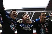 AFC Wimbledon goalkeeper Kelle Roos (29), Ashley Bayse and AFC Wimbledon goalkeeper James Shea (1) celebrate during the Sky Bet League 2 play off final match between AFC Wimbledon and Plymouth Argyle at Wembley Stadium, London, England on 30 May 2016.