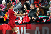 Liverpool women midfielder Jade Bailey (8) hands out scarfs to young fans during the FA Women's Super League match between Liverpool Women and Everton Women at Anfield, Liverpool, England on 17 November 2019.