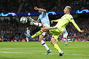 Dinamo Zagreb defender Marin Leovac (22) clears the ball under pressure from Manchester City midfielder Riyad Mahrez (26) during the Champions League match between Manchester City and Dinamo Zagreb at the Etihad Stadium, Manchester, England on 1 October 2019.