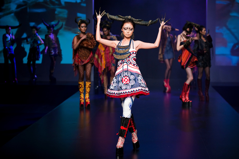 HONG KONG - JANUARY 17:  A model showcases designs by Ika Butoni of Indonesia during the 'Butterfly Momma' show as part of the Hong Kong Fashion Week Fall/Winter on January 17, 2011 in Hong Kong, China.  Photo by Victor Fraile / studioEAST