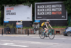 "© Licensed to London News Pictures; 15/07/2020; Bristol, UK. #WhoseFuture campaign outdoor art. Two billboards saying ""Actions over Apologies"" and ""Black Lives Matter"" are seen in Bristol as part of a month long arts exhibition starting this week called ""Whose Future"" by Rising Arts Agency. The month-long outdoor art exhibition is using spaces normally given over to adverts across the city. The work by dozens of young Bristol artists aims to provide a platform for new voices while also asking questions about Bristol's future, and as a response to the ongoing Black Lives Matter campaign, as well as inequalities suffered by young people and the impact on them from the wider Covid-19 lockdown. Bristol hit world headlines when the statue of slave trader Edward Colston was pulled down with ropes and thrown into Bristol docks on 07 June during an All Black Lives/Black Lives Matter protest. Today a new sculpture titled ""A Surge of Power (Jen Reid) 2020"" by artist Marc Quinn made of black resin and steel was put up on the plinth where the statue of Colston previously stood without any permission from Bristol City council. Jen Reid stood on the empty plinth at the previous protest on 07 June which was in protest for the memory of George Floyd, a black man who was killed on May 25, 2020 in Minneapolis in the US by a white police officer kneeling on his neck for nearly 9 minutes. The killing of George Floyd has seen widespread protests in the US, the UK and other countries. Photo credit: Simon Chapman/LNP."