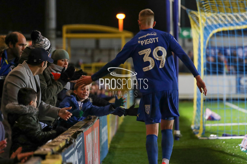 AFC Wimbledon striker Joe Pigott (39) touching hands/ slapping with fans during the EFL Sky Bet League 1 match between AFC Wimbledon and Gillingham at the Cherry Red Records Stadium, Kingston, England on 23 November 2019.
