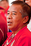 """Mar. 27, 2010 - BANGKOK, THAILAND:  Red Shirt leader Veera Musigapong speaks at a Red Shirt rally in Bangkok Saturday, Mar 27. More than 80,000 members of the United Front of Democracy Against Dictatorship (UDD), also known as the """"Red Shirts"""" and their supporters marched through central Bangkok March 27 during a series of protests against and demand the resignation of current Thai Prime Minister Abhisit Vejjajiva and his government. The protest is a continuation of protests the Red Shirts have been holding across Thailand. They support former Prime Minister Thaksin Shinawatra, who was deposed in a coup in 2006 and went into exile rather than go to prison after being convicted on corruption charges. Thaksin is still enormously popular in rural Thailand.    PHOTO BY JACK KURTZ"""