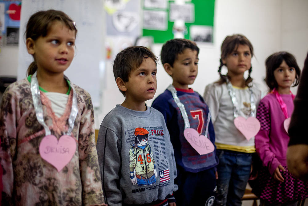 """Denisa (left) and other children attend the kindergarten in the community center situated in the Roma settlement """"Budulovska Street"""" in Moldava nad Bodvou. The community center was in this time (2014) a metal, prefabricated building, which not only houses the local Roma school, but also serves as a performance space and local hangout for older Roma kids and teenagers. From about 800 inhabitants of the segregated settlement 'Budulovska Street' (2014) are roughly 392 children up to the age of 16 years."""