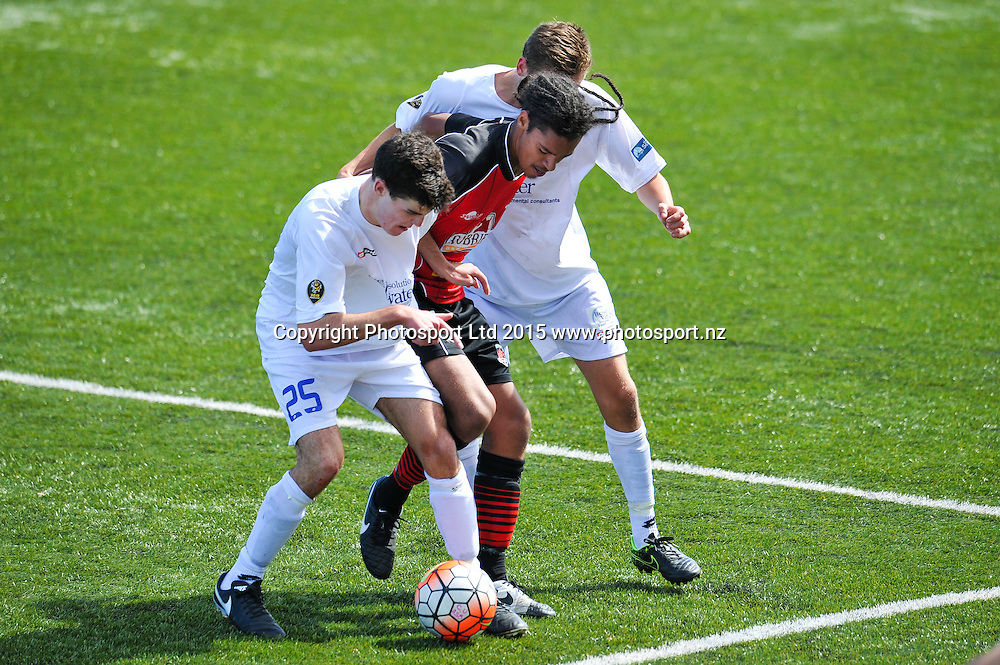 Aaron Spain of Canterbury United get surrounded by Hamish Cotter and Lewis Jackson of Southern United during the ASB Premiership Football match, Canterbury V Southern United, at English Park, Christchurch. 28th Febuary 2016. Copyright Photo: John Davidson / www.photosport.nz
