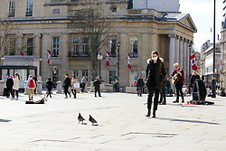 © Licensed to London News Pictures. 16/03/2020. London, UK. Woman wearing a face mask outside nearly empty National Gallery as tourist are avoiding crowded area. 35 coronavirus victims have died and 1,372 have tested positive forthe virusin the UK as of9amon Sunday, 15 March 2020. Photo credit: Dinendra Haria/LNP