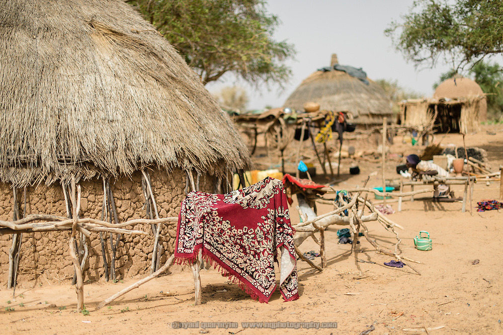 A prayer rug hanging on a fence in a nomadic Fulani encampment in Garinbale in the Commune of Soukoukoutan in the Dosso Region of Niger on 23 July 2013.
