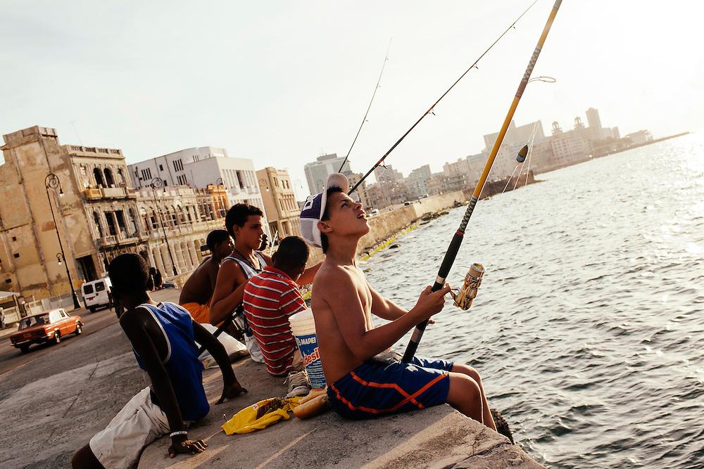 Kids fish off of the Malecon in Havana, Cuba