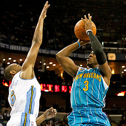 October 29, 2010; New Orleans, LA, USA; New Orleans Hornets point guard Chris Paul (3) shoots over Denver Nuggets shooting guard Arron Afflalo (6)during the fourth quarter at the New Orleans Arena. The Hornets defeated the Nuggets 101-95.  Mandatory Credit: Derick E. Hingle