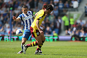 Brighton striker, Anthony Knockaert (27) battles with Burnley midfielder George Boyd (21) during the Sky Bet Championship match between Brighton and Hove Albion and Burnley at the American Express Community Stadium, Brighton and Hove, England on 2 April 2016. Photo by Phil Duncan.