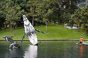 Malaysia, Kuala Lumpur. Whale sculptures at Kuala Lumpur City Centre Park.