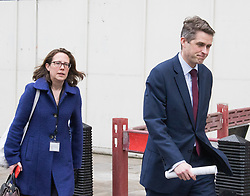 Scotland Yard, London, March 23rd 2017. Lord Privy Seal and Leader of the House of Lords Baroness Natalie Evans  and Chief Whip (Parliamentary Secretary to the Treasury) Gavin Williamson head towards Parliament as investigations continue in the aftermath of Tuesday's terrorist attack on Westminster Bridge and in the grounds of Parliament, in which four people and their attacker were killed with over 40 injured.