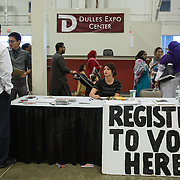 "CHANTILLY, VA - SEP12: A voter registration booth following prayers at the Dulles Expo Center for Eid al-Adha, the ""Feast of the Sacrifice"", the second of two major holidays in Islam, September 12, 2016, in Chantilly, Vriginia.  The holiday honors the willingness of Ibrahim (Abraham) to sacrifice his son, as an act of submission to God's command. (Photo by Evelyn Hockstein/For The Washington Post)"