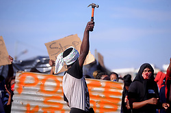 South Africa - Cape Town - 07 June 2020 - Backyarders from Joe Slovo in Milnerton invaded a section of vacant land in Democracy Way. They say their landlords have asked them to leave because they couldn't pay their rent of R1500 to live in a shack. They are now moving around asking for shelter from other people. Most of them are not working anymore since the lockdown began. They tried several times to call local authorities to ask for help. They are prepared to die on the land that they're invading. Photographer: Ayanda Ndamane/African News Agency(ANA)