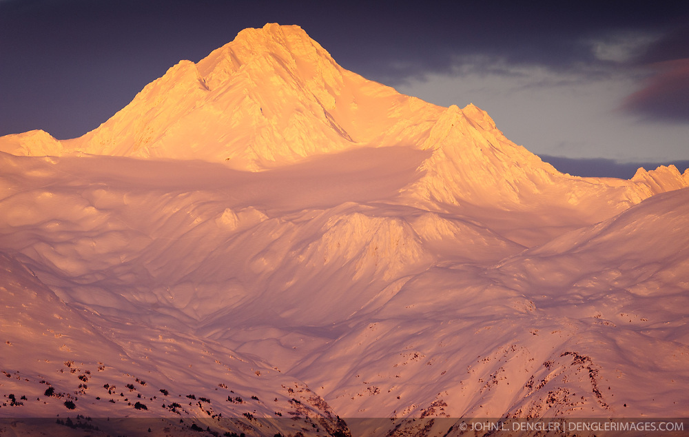 Four Winds Mountain near Haines, Alaska and near the border with Alaska and British Columbia, Canada are bathed in early morning sunrise light. The mountain can be seen from the Alaska Chilkat Bald Eagle Preserve. Mountains in the Haines area are a popular destination for heli-skiing.