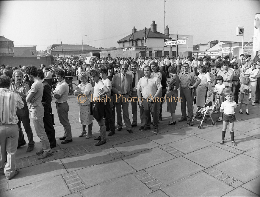 Croke Park Ticket Queues.1983.28.08.1983.08.28.1983.28 August 1983.Image taken as thousands of Dubliners queue to capture vital All Ireland Replay Tickets. The replay Between Dublin and Cork was to be held in Cork. The queue calmly waits in the hope of securing tickets...Note: Dublin beat Cork in a very exciting encounter and the went on to beat Galway 1.10 to 1.08 in the final at Croke Park.