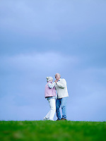 Senior couple embracing outdoors (low angle view)