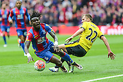 Crystal Palace's Pape N'Diaye Souaré and Watford's Almen Abdi clash during the The FA Cup match between Crystal Palace and Watford at Wembley Stadium, London, England on 24 April 2016. Photo by Shane Healey.