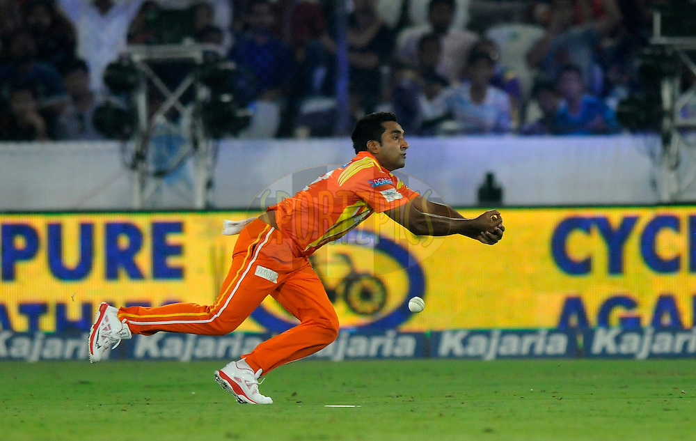 Asif Raza of Lahore Lions drops a catch of Robin Uthappa of Kolkata Knight Riders during match 7 of the Oppo Champions League Twenty20 between the Kolkata Knight Riders and the Lahore Lions held at the Rajiv Gandhi Cricket Stadium, Hyderabad, India on the 21st September 2014<br /> <br /> Photo by:  Pal Pillai / Sportzpics/ CLT20<br /> <br /> <br /> Image use is subject to the terms and conditions as laid out by the BCCI/ CLT20.  The terms and conditions can be downloaded here:<br /> <br /> http://sportzpics.photoshelter.com/gallery/CLT20-Image-Terms-and-Conditions-2014/G0000IfNJn535VPU/C0000QhhKadWcjYs