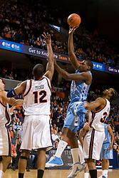 North Carolina forward Deon Thompson (21) shoots over Virginia forward Jamil Tucker (12).  The Virginia Cavaliers men's basketball team faced the #3 ranked North Carolina Tar Heels  at the John Paul Jones Arena in Charlottesville, VA on February 12, 2008.