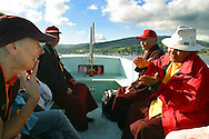 Rinchen Khandro, a Buddhist nun from the Samye Ling community in southern Scotland, chatting to retreat's master Lama Yeshe Losal, on board the tiny passenger ferry from Arran to Holy Island, where the former model, songwriter and fashion designer will spend the next three years in retreat with 11 other women. Her journey to the retreat involves a three-hour drive, two ferry crossings and almost an hour's walk on Holy Island, which is owned by the Buddhist order.