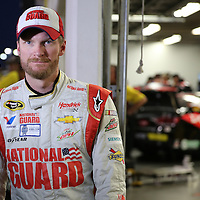 Racecar driver Dale Earnhardt Jr. is seen in his garage area during the  56th Annual NASCAR Daytona 500 practice session at Daytona International Speedway on Wednesday, February 19, 2014 in Daytona Beach, Florida.  (AP Photo/Alex Menendez)
