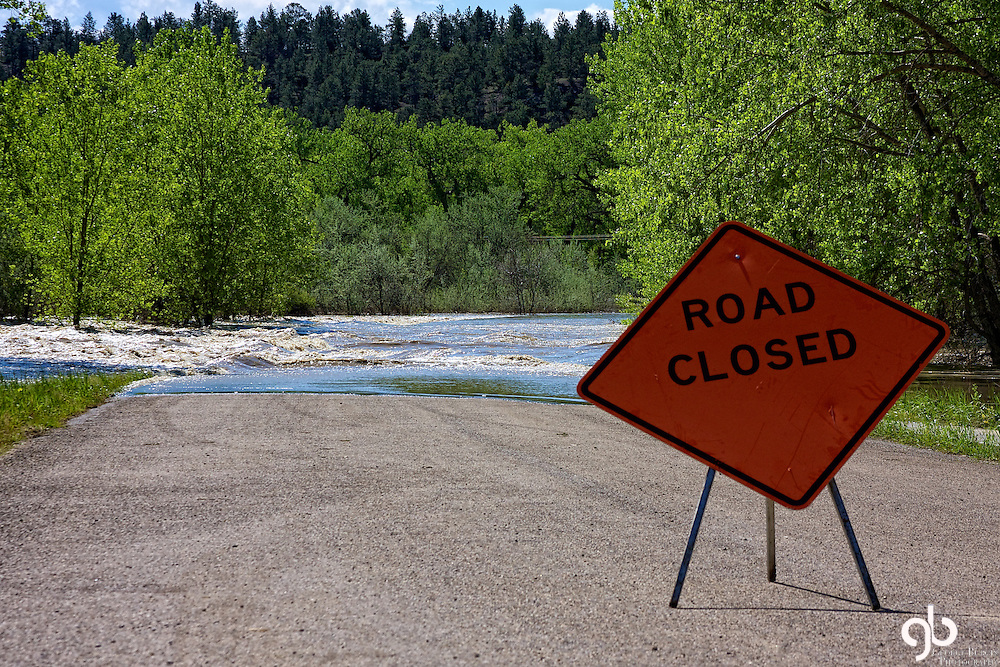 Road to the Musselshell County fairgrounds closed due to flooding of the Musselshell River during the Spring of 2011.